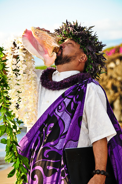 Maui minister blowing conch shell